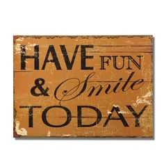 """Furnistar Decorative Wood Wall Hanging Sign Plaque """"Have Fun & Smile Today"""" Brown. Add a splash of color and style to the bedroom kitchen or front hall with this lovely reminder to smile. Bold text reads Have fun and smile today in block and script lettering on a brown antiqued background. This simple sweet piece complements many decor styles and makes a wonderful housewarming wedding or anniversary gift"""