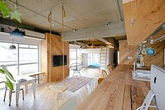 Tomoko Sasaki and Kei Sato, founders of Japanese studio 8 Tenhachi, have recently renovated this 67 sqm apartment just outside of Tokyo to create a big open space with two open box spaces for their own family.