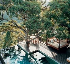 how relaxing would that deck be! I like that they used the tree in the design...