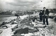 "One of the more powerful images from D-Day. The photograph was snapped by Robert Capa, but has been widely overlooked because his 11-photo set from the beach landing are so important to the ""American WWII experience"" lexicon. The sheer destruction to..."