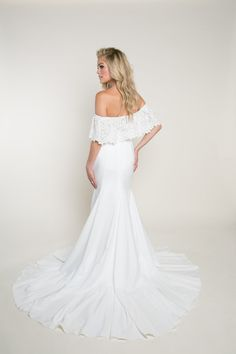 Fitted Off-The-Shoulder Wedding Dress | Sparrow Darling | This off-the-shoulder, crepe wedding dress features a form fitting silhouette. The front panel of the skirt is seamless while the godets at the side and back seam create a soft, flowing drape effect. The off-the-shoulder bodice was created out of a guipure lace. Visit our website to learn more about this fitted wedding dress with lace. #wedding #weddinginspo #bride #weddingdress #bridalinspo #bohobride #fittedweddingdress…