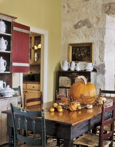 rustic dining table with pumpkin centerpiece