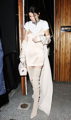 Kendall Jenner masters monochrome with a beige slip dress + over the knee boots + bag.