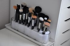 Makeup Brushes! Brilliant idea...put them in a vase with glass beads!