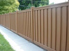 Brown Painted Wooden Fences : Selecting Primer for Outdoor Wooden Fences