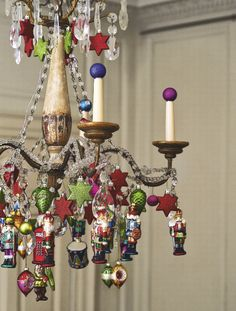 This cool decorating idea sees colourful decorations affixed to a large pendant light, a great alternative to a Christmas tree in a modern living room or hallway. Image: Livingetc