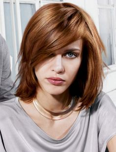 Mid-length hairstyle for wavy hair. http://beautyeditor.ca/2015/01/31/how-to-grow-out-pixie-cut