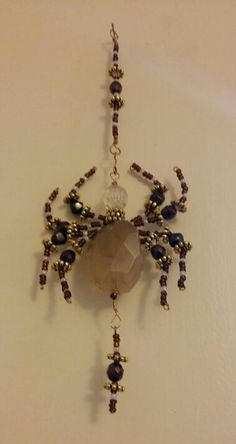 Part of a new collection of hanging beaded spiders ...handmade by PurpleDreamDesign