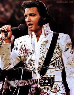 Elvis Presley.  I luv this pic!  This white suit is on display at his home in Graceland!