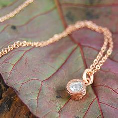 A stunning handmade delicate pendant necklace featuring a solitaire semi-precious white topaz stone in a naturally textured rose gold setting. #Embersjewellery #Jewellery #November #Birthstone #Topaz #Citrine