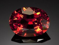 """Rare Spessartite Garnet  Burma   From a rare locality for the mineral, the present stone is exemplary for the species not only for its very large size but also for the saturation of its color, a rich, deep reddish-orange, unhindered by any brown. The transparency is of the highest degree, unmasked by any haze as so many spessartites are. This is a """"gem"""" ---a stone truly worthy of that designation, making it worthy of attention by the most serious collector.   Weighing approximately 15.24…"""