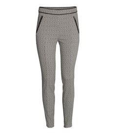 Pants in woven stretch fabric with mock front and back pockets, concealed side zip, and skinny legs with center seams at front and back.