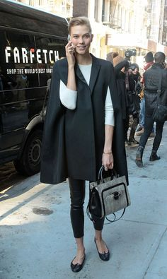 Karlie Kloss in a cape coat and flats