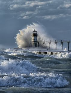"""Crashed Upon"". Photo by Charles Anderson. As winds of 70 mph churn the lake the tower stands strong.St.Joseph Michigan."