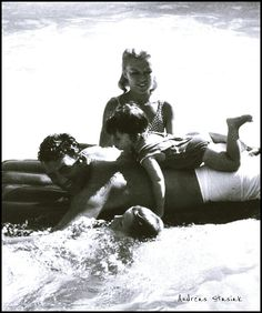 1958: Dean Martin and his wife Jeanne with Gina and Dean-Paul in their pool