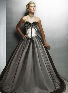 I absolutely love this dress - dark with a little bit of traditional white. :)