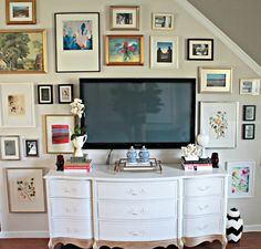 Design around your TV.  Create a gallery wall using your TV and a dresser as your media consul.