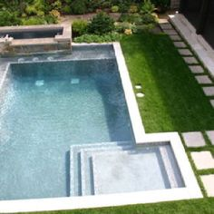 Square:- Love the flag stones set into the grass as well here. Love the steps into the pool also.