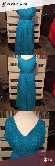 Beautiful Teal Dress Beautiful teal dress!  Never worn, size S. Beautiful detail with tie in back. Brand Jessica Taylor Dresses