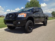 "4"" lift kit on this Nissan Titan. Tuff country lift kit http://www.suspensionconnection.com/54060-titan-lift.html #Nissan #Trucks #Titan #LiftKit #Offroad #4x4 #BigTrucks"