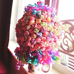 Back to school candy bouquet. Dum dums in a styrofoam ball, glued onto a cute coffee mug and decorated with tissue paper squares and curling ribbon