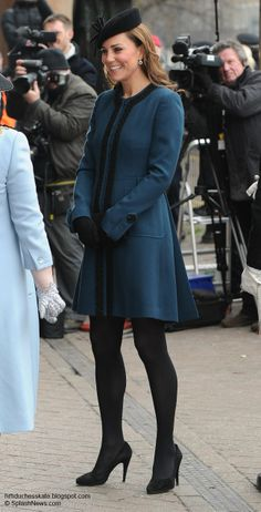 March 20, 2013 Kate joined the Queen and Prince Philip for a visit to London's famous Underground for its 150th anniversary. Kate wore a teal blue By Malene Birger coat for today's engagement. The piece is 100% wool with elaborate trim at the neckline and down the front. There are large tabs at the cuffs and on the outer front pockets, accented by oversized buttons. The piece is closed with concealed hook & eye fastenings.