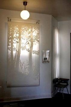 Natalia Ivancevich Hayes is a paper cutting whiz. Her delicately detailed hand cut paper pieces make the sweetest translucent window treatments that create the loveliest layered forest effect. Window Treatment Store, Window Coverings, Unique Window Treatments, Paper Cutting, Cut Paper, Paper Art, Window Dressings, Store Displays, Home And Deco