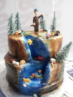 Gone Fishing - carved cake in buttercream with candy rocks and fisherman figuring