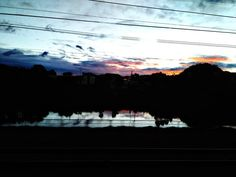 19h45: Rio Pinheiros da janela do trem (Pinheiros river 7:45PM. Photo taken from the window of the train that passes through) (february 2016)