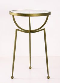 An antiqued gold side table