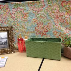 Textured wrapping paper for cubicle walls -- lighter than a heavy blanketesque material, easier to tack up, & probably less expensive. Great idea!