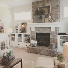 White plank walls surround this stone fireplace for a fresh, modern farmhouse lo. - White plank walls surround this stone fireplace for a fresh, modern farmhouse look. Farmhouse Fireplace Mantels, Fireplace Built Ins, Fireplace Remodel, Cozy Fireplace, Fireplace Surrounds, Fireplace Design, Fireplace Ideas, Fireplace Stone, Airstone Fireplace