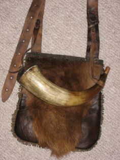 Bark tanned body with a buffalo hair flap. The horn is a restored original.  Photos supplied by Shawn Webster.