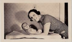 Vintage Antique Photograph Mom Holding Adorable Baby Up Off Changing Table