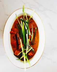 Had to start the Easter weekend off with one of my favourite curries... roasted pumpkin coconut and ginger! It's so easy to make and tastes so good... here is the quick version for anyone that fancies it... Cube and roast half a butternut pumpkin coated in a bit of oil half a teaspoon of cumin seeds half a teaspoon of turmeric salt and pepper then set aside.  In a NutriBullet or small blender whiz up: 2-3 spring onions a 1-inch piece of ginger 1-2 green chillies 3 tablespoons of coconut oil…