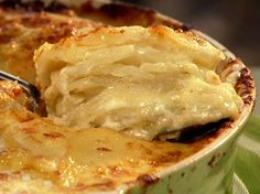 Cheesy Potato Casserole 1 shallot, minced 2 cups heavy cream 1 clove garlic, minced Kosher salt and freshly ground pepper 3 medium russet potatoes (about 2 pounds), peeled and sliced thick 2 cups grated sharp white Cheddar cheese cup grated Parmesan