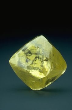 The 253.7-carat Oppenheimer Diamond is in the shape of an octahedron (an eight-sided double pyramid), which is a common shape for diamond crystals.  This diamond is 3.8 cm (1.5 in) in height and was discovered at the Dutoitspan Mine near Kimberley, South Africa in 1964.  The yellow color is due to impurities of nitrogen substituted for some of the carbon atoms as the crystal formed.