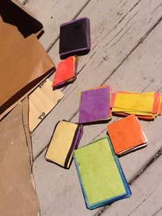 I first made these about 10 years ago, when john and I taught at a summer camp together. The process is very simple, dig up some scraps of construction paper… Cut a whole pile the same size. …
