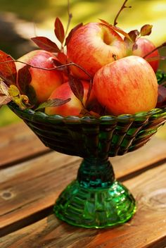 So simple: using your favorite green/brown/gold, etc. bowl, stack apples and throw in some autumn leaves - instant centerpiece!