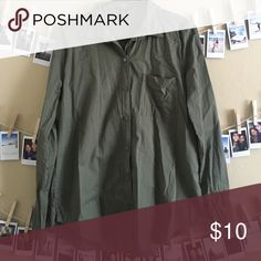 Deep green button down shirt! The color is deep green. It has a little pocket on the front. The fabric is thin and easy to breathe. Forever 21 Tops Blouses
