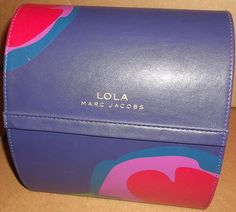Lola by Marc Jacobs Purple Dome Top Treasure Chest/ Beauty Case on ebay for $15.99. Case only.