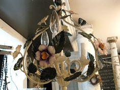 Oh, ADORABLE! What a lovely little old metal flower chandelier from Bloom and Sisters Garden.