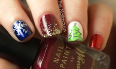 The Nailasaurus: Glitter  I like the maroon finger and the snowflake finger