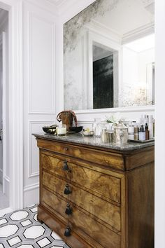Susan Greenleaf San Francisco Home - A wooden set of drawers serving as a vanity in a master bath