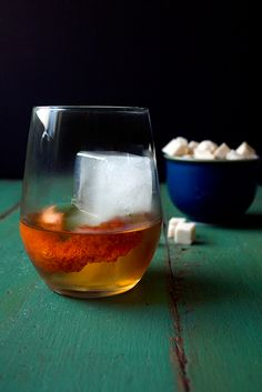Smoked Sugar and Sour Cherry Old Fashioned - Smoked Sugar Cubes (Recipe), Sour Cherry Bitters, Bourbon, Blood Orange Peel for Garnish.