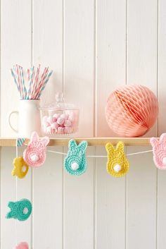 Free pattern by Laura Maxell - Crochet Bunny Garland @ Mollie Makes -  made in one piece.