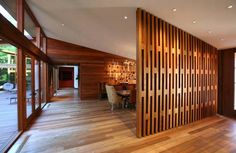 Dramatic teak entry hall