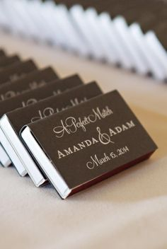 Guests will think of you every time they light a candle with these personalized matchbox wedding favors.