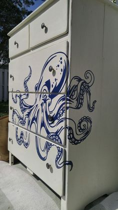 Solid Wood Dresser painted in Annie Sloan Old White, distressed, wrapped with a large royal blue octopus decal and finished in soft wax