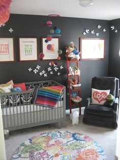 Totally different but cute, love the prints on the wall--love that blanket!